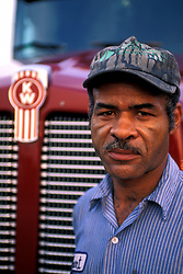 Blue Collar African American Man in Fron of Truck