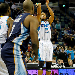 December 21, 2011; New Orleans, LA, USA; New Orleans Hornets shooting guard Eric Gordon (10) shoots a three pointer against the Memphis Grizzlies during the first quarter of a game at the New Orleans Arena.   Mandatory Credit: Derick E. Hingle-US PRESSWIRE