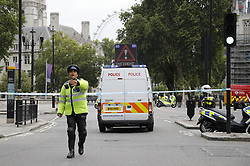 © Licensed to London News Pictures. 14/08/2018. London, UK. Police are seen outside Parliament after a car crashed into security barriers in Parliament Square. Photo credit: Tolga Akmen/LNP