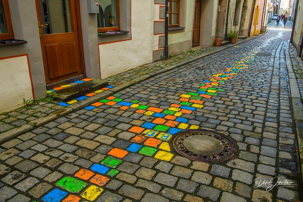 Cobblestone alleyway and painted artist's walk, Passau, Bavaria, Germany