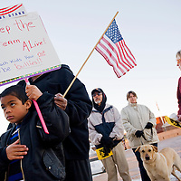 """012013       Cable Hoover<br /> <br /> Seven-year-old Call Lemon carries a sign that reads """"Keep the Dream Alive"""" as he stand for the National Anthem during the Martin Luther King day rally at the McKinley County Courthouse plaza in Gallup Sunday."""