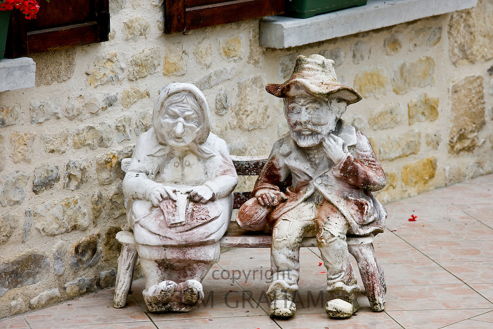 Garden ornament in paved garden in Liesville-sur-Douve, Normandy, France