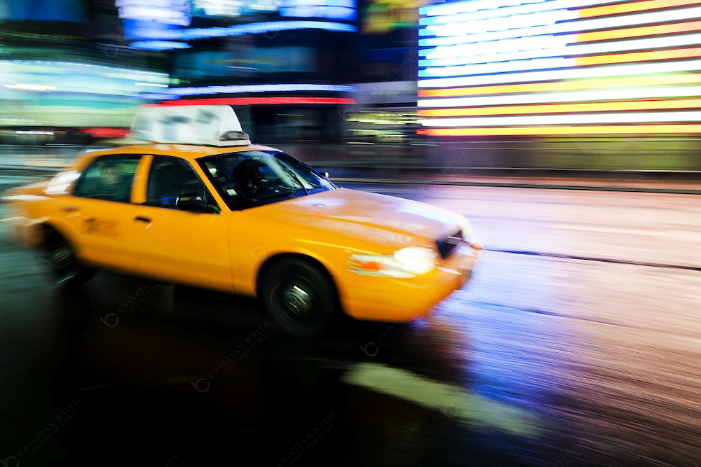 Taxi driving through Times Square in New York