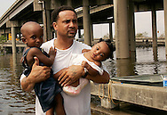 Jaquin Johnson (R), 2, and Heaven Girod, 5 months, are evacuated by Larry Harrison from a flooded area in New Orleans, August 30, 2006. Hurricane Katrina strengthened into a rare top-ranked storm and barrelled into the vulnerable U.S. Gulf Coast for a second and more deadly assault on the Gulf Coast. REUTERS/Rick Wilking