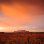 """Watching the colours change over this amazing landscape in Uluru is a breathtaking experience. This sacred rock, a male symbolism, stands over a desert with know sister """"Olga"""", a nearby rock formation, symbol of feminity."""