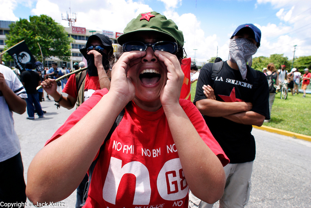 09 SEPTEMBER 2003 - CANCUN, QUINTANA ROO, MEXICO: Anti-globalization protestors march through Cancun, Mexico during the World Trade Organization Ministerial meetings in Cancun. A few thousand people participated in the march, which was stopped by Mexican law enforcement at the edge of the city of Cancun, several miles from the WTO meeting site at the Cancun Convention Center. Up to 20,000 anti-globalization protestors are expected in Cancun for the WTO ministerial meetings.  PHOTO BY JACK KURTZ