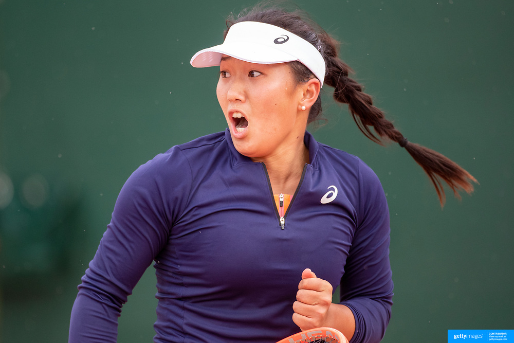 PARIS, FRANCE May 25.  Claire Liu of the United States celebrates her victory against Rebecca Marino of Canada on the second day of the qualifying tournament at the 2021 French Open Tennis Tournament at Roland Garros on May 25th 2021 in Paris, France. (Photo by Tim Clayton/Corbis via Getty Images)