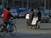 couple riding there bicycle while looking for work Beijing China