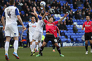Oldham Athlteic's Charlie MacDonald and Tranmere Rovers' Steven Jennings challenge for the ball. Skybet football league 1match, Tranmere Rovers v Oldham Athletic at Prenton Park in Birkenhead, England on Saturday 1st March 2014.<br /> pic by Chris Stading, Andrew Orchard sports photography.
