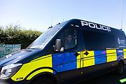 Pole van passing the peaceful event in New Preston Road, Lancashire, United Kingdom, June 29th 2018.  Block Around the Clock - a fourty eight hours of event with work shops, yoga, sleeping and anti-fracking campaigning in front of the gates to Cuadrillas fracking site in Lancashire. The event was organised by anti-fracking campaigners in spite of an injunction granted to Cuadrilla to prevent protest against the impending shale gas exploitation. The Cuadrilla site in Lancashire in a highly contested site, almost ready to drill for gas.