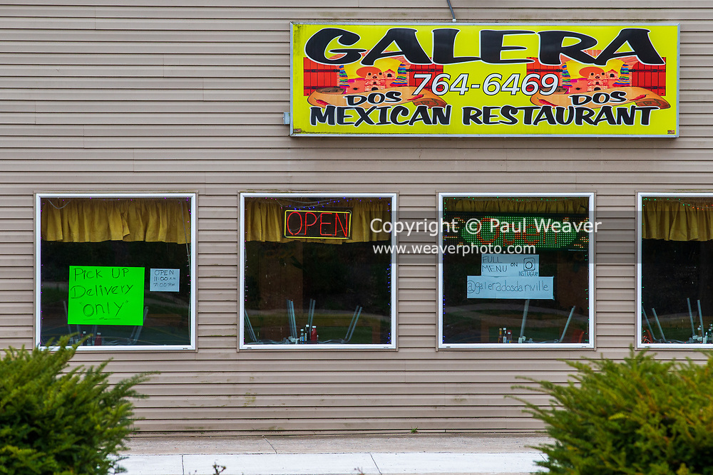 April 3, 2020 -- Galera Dos Mexican Restaurant has a sign in the window to let customers know they are open only for pick up or delivery during the COVID-19 pandemic.