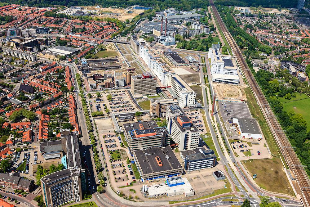 Nederland, Noord-Brabant, Eindhoven, 27-05-2013; Strijp-S, voormalige Philipsterrein, was niet toegankelijk voor het publiek, 'de verboden stad'. Het gebied, met diverse Rijksmonumenten, wordt ontwikkeld voor wonen, werken en cultuur.<br /> Rechts naast spoorlijn Philitefabriek met Klokgebouw (Strijp S), in het midden het Veemgebouw en De Hoge (Witte) Rug. <br /> <br /> Strijp-S, former Philips area, was not accessible to the public, 'the forbidden city'. The area, with several national monuments, is designated for living, working and culture.<br /> Next to railroad Philitefabriek / Clock Building (Strijp S), in the middle of the Veemgebouw and the High (White) Back. <br /> <br /> luchtfoto (toeslag op standard tarieven);<br /> aerial photo (additional fee required);<br /> copyright foto/photo Siebe Swart