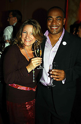 Newsreader DARREN JORDAN and CARIE BOLSOVER at the Pink Ribbon Party - A night of Fashion and Music in aid of 3 cancer charities, Breast Cancer Haven, Cancer Resource Centre and Positive Action on Cancer, held at the Waldorf Hilton Hotel, Aldwych, London on 19th October 2004. <br />