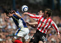 Photo: Lee Earle.<br /> Portsmouth v Sunderland. The Barclays Premiership. 22/04/2006. Pompey's Richard Hughes (L) battles with Chris Brown (R).