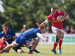 June 16, 2018 - Ottawa, ON, U.S. - OTTAWA, ON - JUNE 16: Nick Blevins (12 Centre ) of Canada stiff arms Kirill Golosnitskiy (13 Centre) of Russia in the Canada versus Russia international Rugby Union action on June 16, 2018, at Twin Elms Rugby Park in Ottawa, Canada. Russia won the game 43-20. (Photo by Sean Burges/Icon Sportswire) (Credit Image: © Sean Burges/Icon SMI via ZUMA Press)