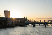 Sunrise over London seen from Millennium Bridge, London, England, UK