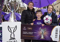 CARDIFF, ENGLAND - Tuesday, February 21, 2017: Stefan Roberts, the first person to buy a ticket poses with Jayne Ludlow, 2017 Women's Champions Legue Final Ambassador and Karen Espelund,UEFA Chair of Women's Football Committee, in the Hayes, Cardiff to promote the UEFA Champions League Finals being staged in Cardiff this June. (Pic by Paul Greenwood/Propaganda)