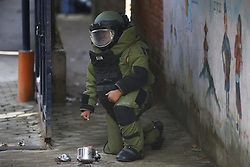 September 20, 2016 - Kathmandu, Nepal - A Nepalese Army bomb disposal personnel posing for a photograph after defusing a pressure cooker bomb at Kanchanjunga School in Dallu, Kathmandu, Nepal on Tuesday, September 20, 2016. Improvised explosive devices were placed in 7 schools as 2 bombs exploded. No human casualties have been reported in the explosions. (Credit Image: © Skanda Gautam via ZUMA Wire)