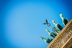 Detail of  Quadriga statue on top of Brandenburg Gate in Berlin Germany