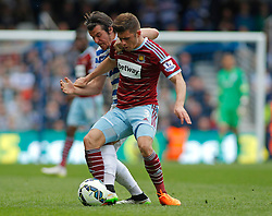 Queens Park Rangers' Joey Barton and West Ham United's Aaron Cresswell compete for the ball - Photo mandatory by-line: Mitchell Gunn/JMP - Mobile: 07966 386802 - 25/04/2015 - SPORT - Football - London - Loftus Road<br />  - QPR v West Ham United - Barclays Premier League