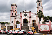Cathedral of Saint Joseph and Saint Andrew in San Andres Tuxtlas, Veracruz, Mexico. The church was built in 1870 features bell towers and a sober facade with Neoclassical influence