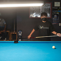 Treyshawn Bia, 13, practices pool Tuesday evening at Q & A Billiards in Gallup. She is learning competitive billiards from Gina Kim, the owner of Q&A Billiards.