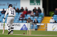 Wicket! Tom Kohler-Cadmore of Yorkshire bowled by James Fuller of Hampshire during the opening day of the Specsavers County Champ Div 1 match between Yorkshire County Cricket Club and Hampshire County Cricket Club at Headingley Stadium, Headingley, United Kingdom on 27 May 2019.