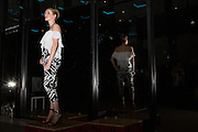 Guests enjoy food, beer, music, and a fashion show during the Conetnt Magazine Pick Up Party at The GlassHouse San Jose in San Jose, California, on April 14, 2015. (Stan Olszewski/SOSKIphoto)