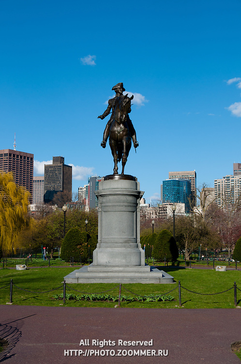 George Washington statue In Boston Public Garden in a sunny spring day over bright blue sky