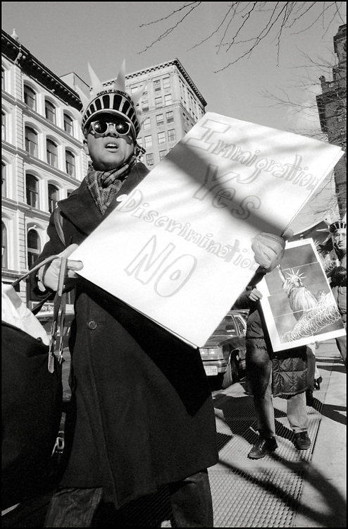On World's AIDS Day, December 1, 1989, ACT UP picketed at the Immigration and Naturalization Services building in lower Manhattan. The group was protesting the prohibition of all infected persons from obtaining U.S. tourist visas or permanent residence status unless they obtained a special waiver.