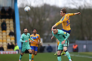 Mansfield Town forward Danny Rose (32) wins a header during the EFL Sky Bet League 2 match between Mansfield Town and Carlisle United at the One Call Stadium, Mansfield, England on 1 February 2020.