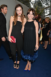 Left to right, ANTONIA CLARKE and OPHELIA LOVIBOND at the Glamour Women of The Year Awards in Association with Next held in Berkeley Square Gardens, Berkeley Square, London on 3rd June 2014.