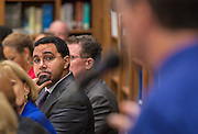 Acting US Secretary of Education John King listens to comments during a roundtable discussion at Sharpstown High School, January 15, 2016.