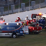 Kyle Busch (54) is loaded into an ambulance while lying on a stretcher after crashing during the Alert Today Florida 300 XFinity Series race at Daytona International Speedway on Saturday, February 21, 2015 in Daytona Beach, Florida. It has been reported Busch has a broken leg and will not race in the 2015 Daytona 500 race. (AP Photo/Alex Menendez)