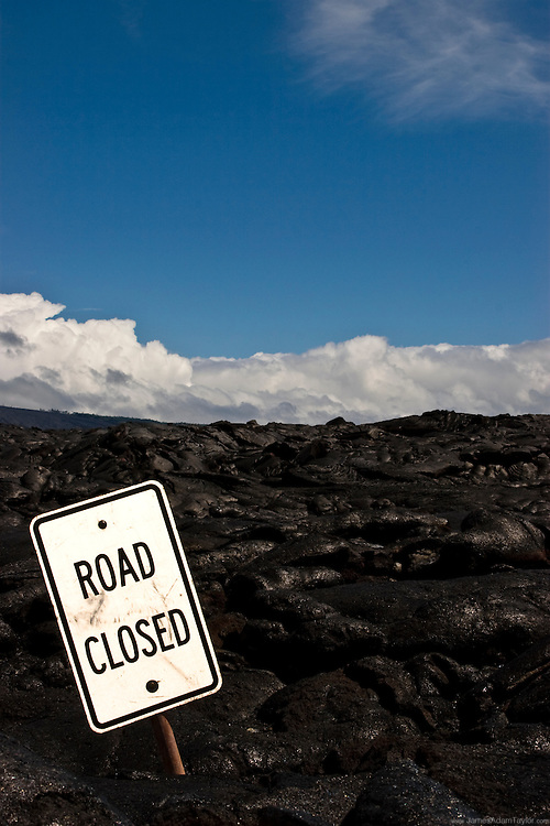 A sign warns of what seems to be an obvious road closure on Hawaii's Chain of Craters road in Volcanoes national park.