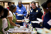 MILWAUKEE, WI – MARCH 28: Milwaukee Police Captain Timothy Heier receives a meal from community members at Grace Fellowship Church on Monday, March 28, 2016. Heier and nine other Milwaukee Police Department officers were in attendance for a Zeidler Center Police and Resident Discussion in the Harambee neighborhood.