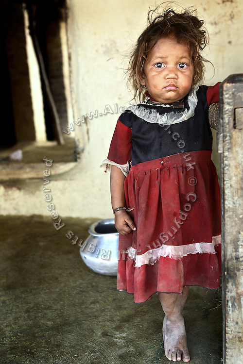 A young girl from Joana, pop. 1800, Kanpur, Uttar Pradesh, is standing in front of her house. The inhabitants of the village are affected by the wastewater originated from the nearby Jajmau Industrial Area, the largest leather producing hub in India, discharging directly into the holy Ganges River.