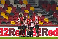 Football - 2020 / 2021 Sky Bet (EFL) Championship - Brentford vs. Wycombe Wanderers  - Brentford Community Stadium<br /> <br /> Sergi Canos (Brentford  FC) celebrates with his team mates after scoring<br /> <br /> COLORSPORT/DANIEL BEARHAM