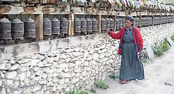 THEMENBILD - Trekkingtour in Nepal um die Annapurna Gebirgskette im Himalaya Gebirge. Das Bild wurde im Zuge einer 210 Kilometer langen Wanderung im Annapurna Gebiet zwischen 01. September 2012 und 15. September 2012 aufgenommen. im Bild eine nepalesische Frau dreht Gebetsmühlen in der Ortschaft Manang // THEME IMAGE FEATURE - Trekking in Nepal around Annapurna massif at himalaya mountain range. The image was taken between september 1. 2012 and september 15. 2012. Picture shows nepalese woman turns prayer mills in manang, NEP, EXPA Pictures © 2012, PhotoCredit: EXPA/ M. Gruber