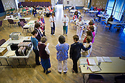 08 DECEMBER 2010 - PHOENIX, AZ:  Volunteers at a Mission of Mercy mobile clinic in Phoenix, AZ, start the clinic session with a prayer Wednesday, Dec. 8. Mission of Mercy has been providing free medical help for people in the Phoenix area since 1997. In the last two years, as the Arizona economy continued its recessionary slide, patient load at the clinics has more than doubled. Mission of Mercy, which relies on voluntary medical help and financial donations, recently acquired another mobile clinic so they could expand their reach into suburban areas they previously had not served. Mission of Mercy has provided free medical help to more than 43,000 patients in the Phoenix area since 1997.    PHOTO BY JACK KURTZ