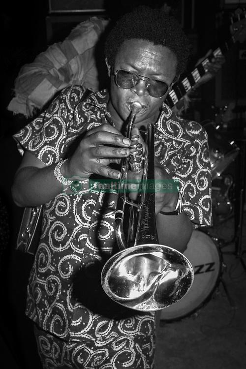 January 23, 2018 - Kinshasa, Kinshasha / Democratic Republic, U.S. - Hugh Masekela playing trumpet in Zaire, Africa in 1974. Performing for The Rumble in the Jungle boxing event between Muhammad Ali vs George Foreman. (Credit Image: © Lynn Goldsmith/ZUMA Press)