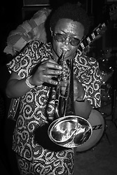 January 23, 2018 - Kinshasa, Kinshasha / Democratic Republic, U.S. - Hugh Masekela playing trumpet in Zaire, Africa in 1974. Performing for The Rumble in the Jungle boxing event between Muhammad Ali vs George Foreman. (Credit Image: © Lynn Goldsmith/ZUMA Press)