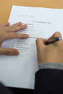 A student is writing a test at Shinil High School, Seoul, South Korea.
