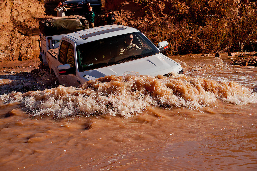 Bill Jamaca crosses the Dirty Devil River on the Pangaea Expeditions Grand Circle Expedition Pre-Scout.