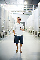 Santiago Santamaria, of Bodega Melipal, stands amonst the fermentation tanks at the winery in the Luján de Cuyo area of Mendoza, Argentina.