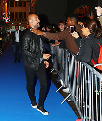 Pep Guardiola is grabbed by an over excited fan arriving for the All or Nothing: Manchester City, world premiere at Vue Printworks, Manchester.