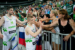 Luka Rupnik of Slovenia and Ziga Dimec of Slovenia greet their fans after basketball match between National teams of Slovenia and France in Quarterfinal Match of U20 Men European Championship Slovenia 2012, on July 20, 2012 in SRC Stozice, Ljubljana, Slovenia. (Photo by Matic Klansek Velej / Sportida.com)
