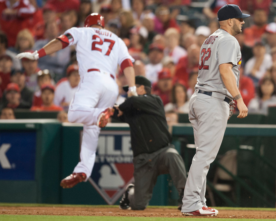 The Cardinals' Matt Adams stands by as Mike Trout runs into first base umpire Rob Drake in the fifth inning Thursday at Angel Stadium. <br /> <br /> ADDITIONAL INFO:   <br /> <br /> angels.0405.kjs  ---  Photo by KEVIN SULLIVAN / Orange County Register  -- 5/12/16<br /> <br /> The Los Angeles Angels take on the St. Louis Cardinals Thursday at Angel Stadium.
