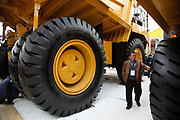 Vistors attend the Bauma 2010, a trade show for heavy machinery, in Shanghai China, on Tuesday, April 12, 2011.  China's economic boom have provided a water shed to manufacturers of heavy machinary as demand fall elsewhere.