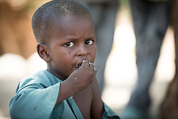 31 May 2019, Mokolo, Cameroon: A young boy enjoys a meal in one of the sites for internally displaced people in Zamay. One of 20 sites for Internally Displaced People in the Far North region of Cameroon, Zamay currently hosts 4,102 IDPs from the border area between Nigeria and Cameroon. Fleeing the atrocities of Boko Haram, and cross-border fighting between Boko Haram and Cameroonian coalition forces, the IDPs have settled alongside the host community of 32,000 people in Zamay.